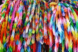 Brightly covered origami paper cranes