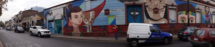 I love that the whole block seems to be covered in street art!