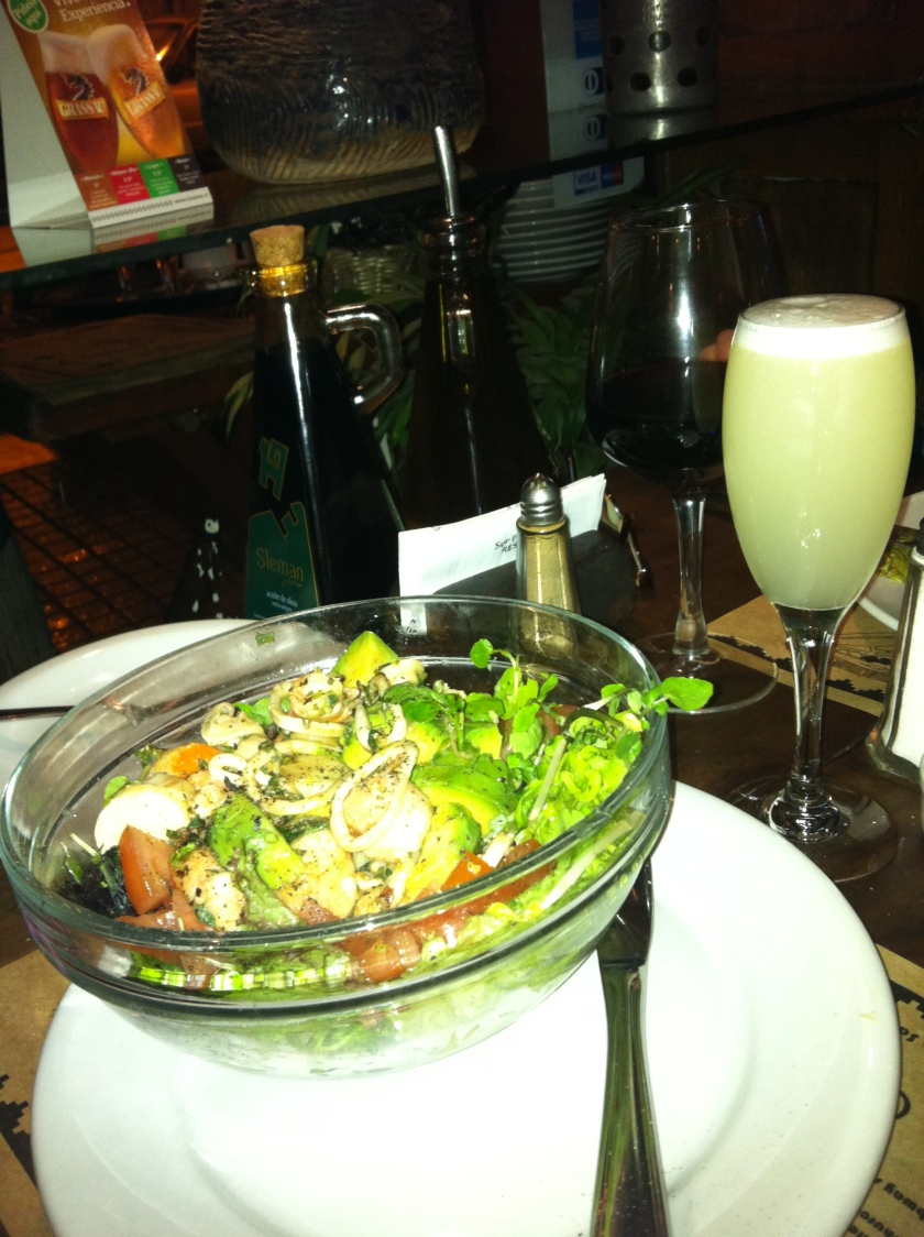 A fabulous seafood salad and my complimentary glass of Pisco Sour!