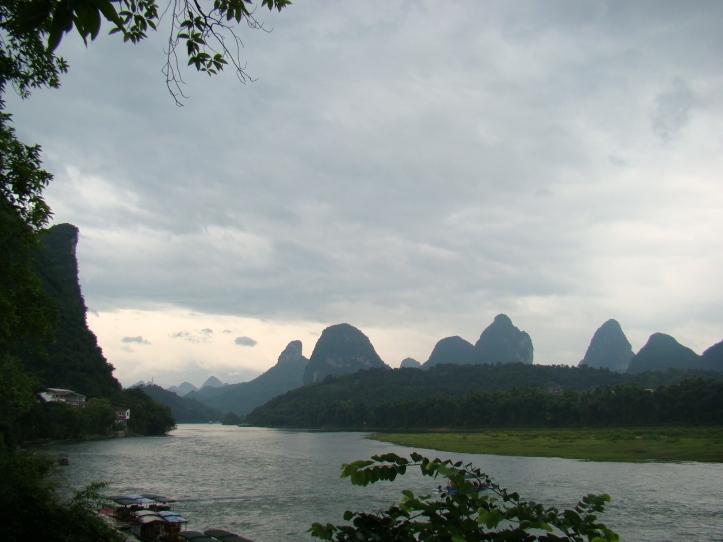 Walking along the Li River flowing through Yangshuo