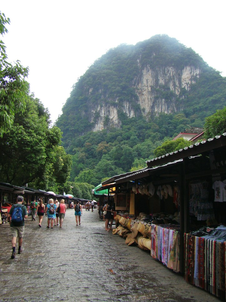 Walking through Yangshuo market right next to the river