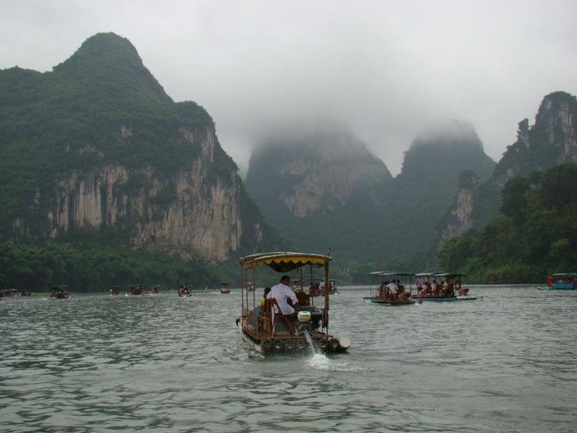 Cruising down the Li River on a powered bamboo raft