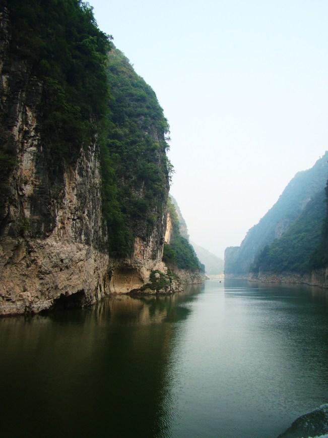 Steep limestone cliffs rise on both sides