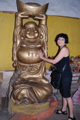 Rubbing Buddhas tummy for good luck!