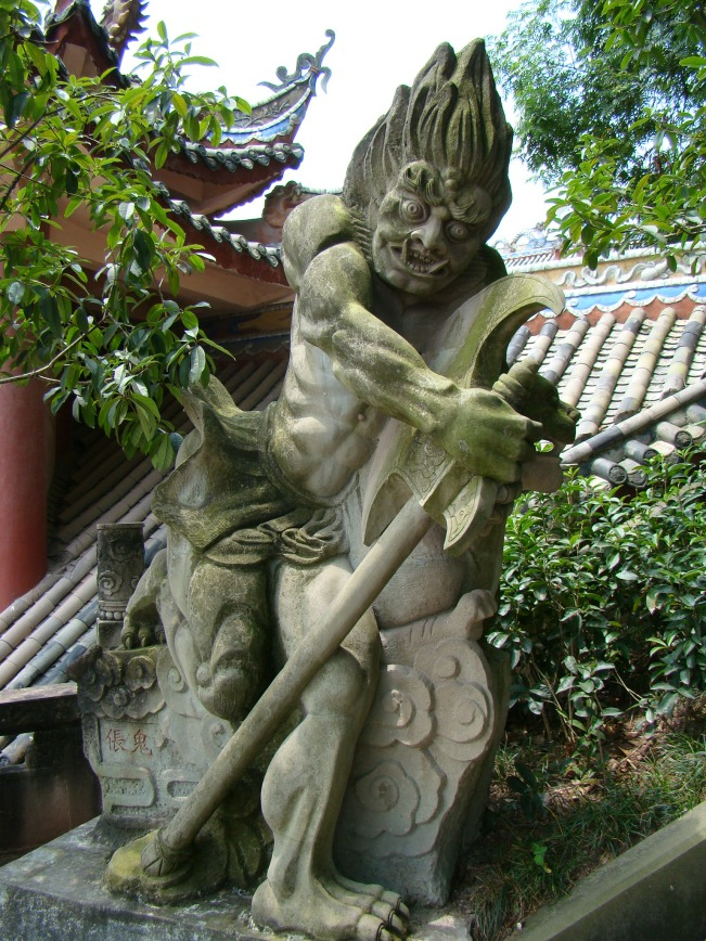 Sculptures depicting ferocious demons along the Torturing Pass