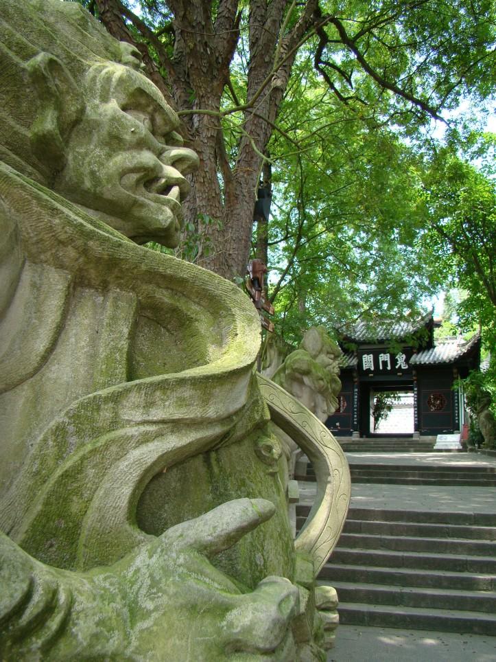 Sculptures depicting ferocious demons along the Torturing Pass