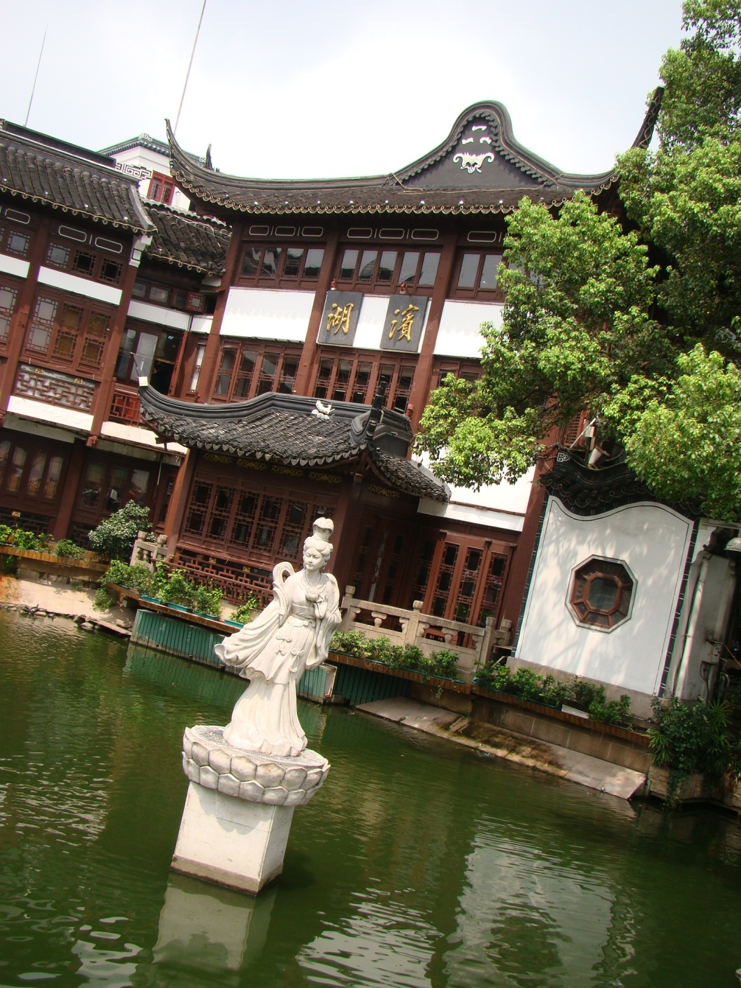 The Teahouse is surrounded by a small lake