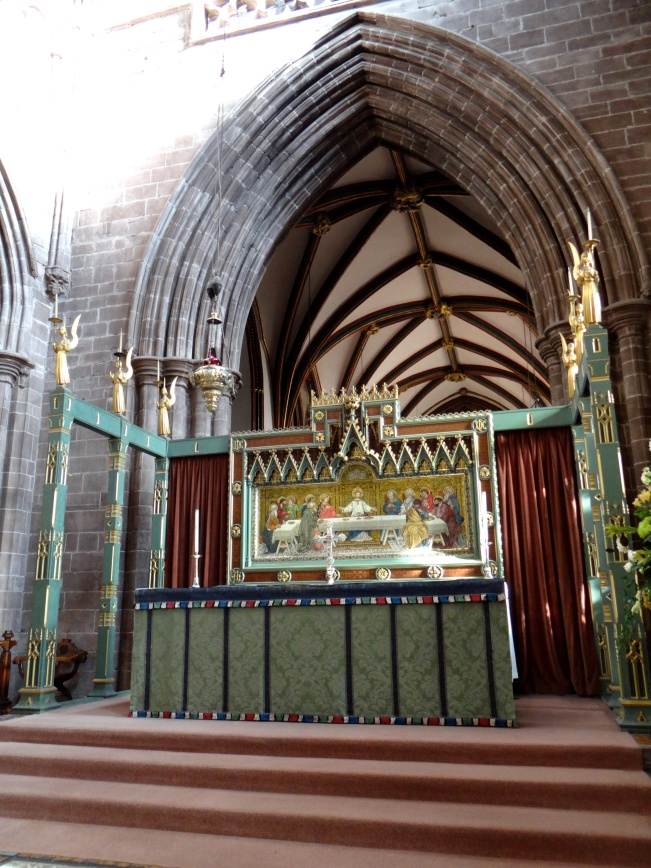 The Chancel- the High Altar has a reredos by J.R. Clayton of Clayton and Bell, and a seasonal altar frontal in the Art Nouveau style.