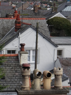 The chimney covered roof tops of Conwy