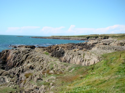 Walking along the rocky coastline of Wales