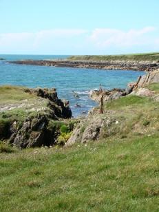 Walking along the rocky coastline of Wales