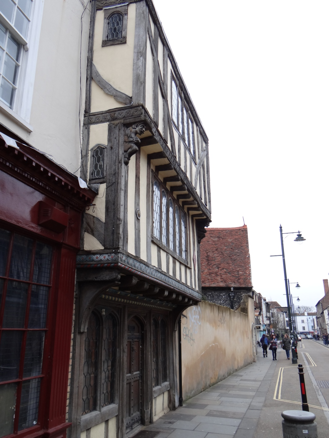 This  half-timbered building has two projecting upper stories over a ground floor
