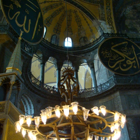 Interior view of the Hagia Sophia, showing Islamic elements on the top of the main dome.