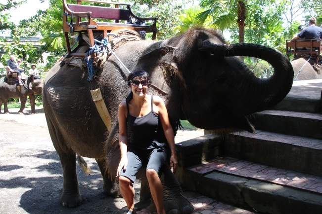 Riding an elephant in Bali