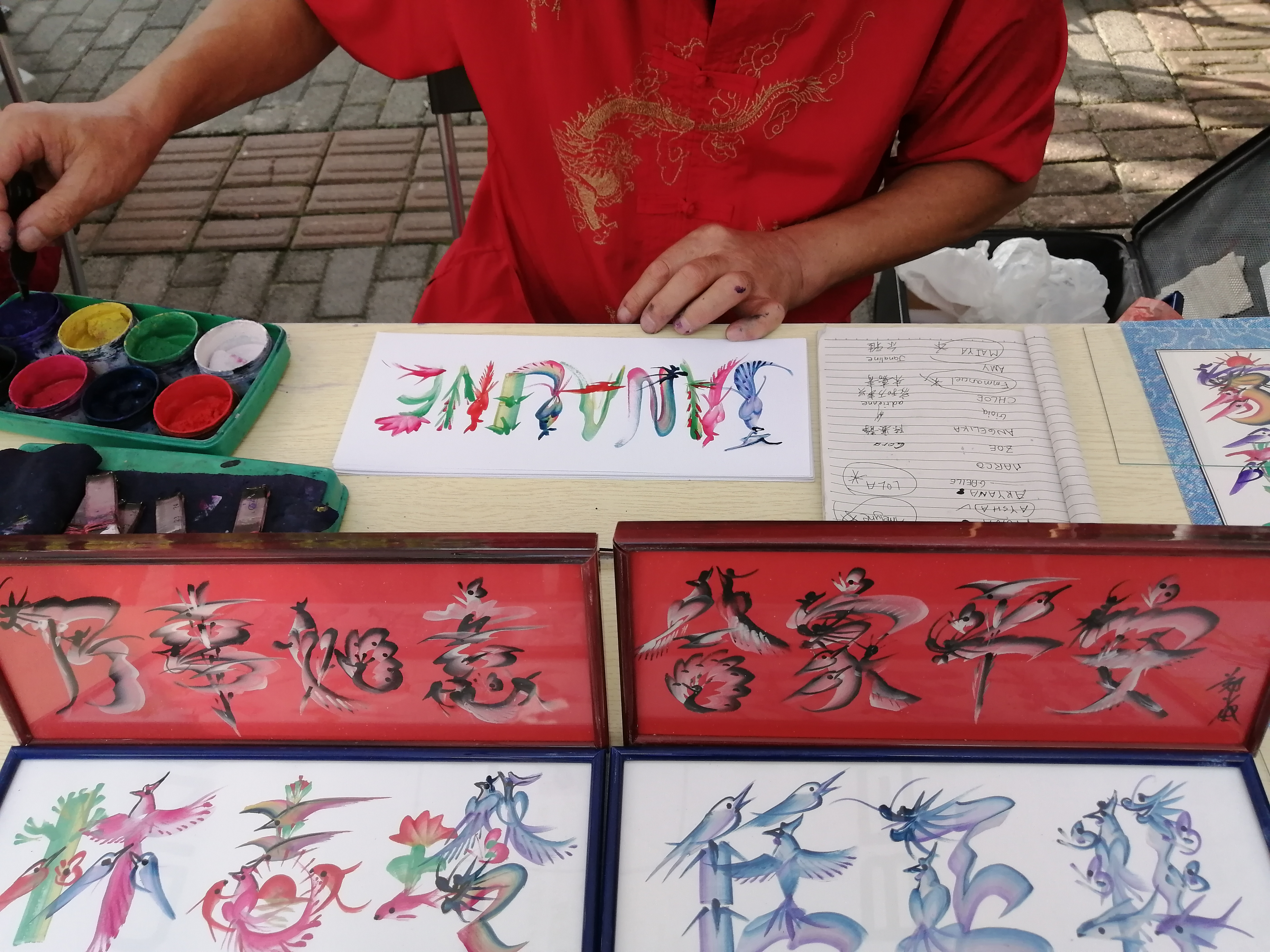 Chinese Calligraphy artist at work